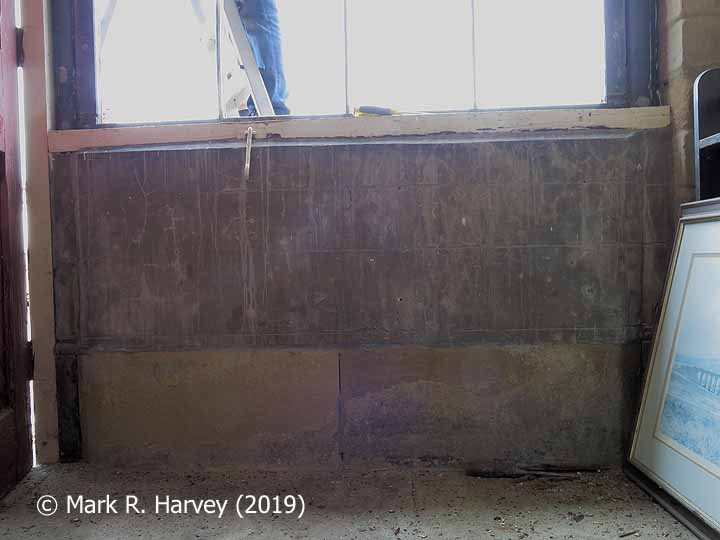 Glazed screen during restoration: 04 - Stone base in-fill from inside.