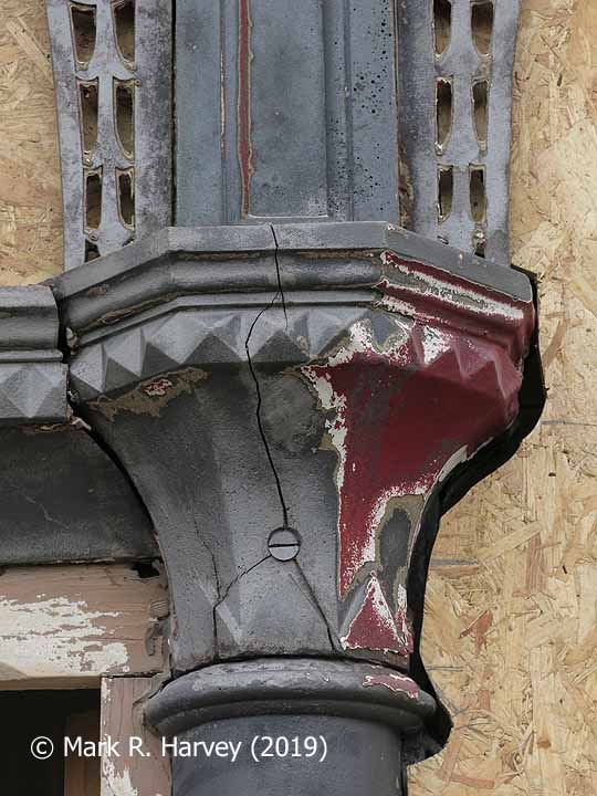 Glazed screen during restoration: 13 - Cracked capital collar and old paint layers.