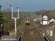 Photo: Appleby Junction, featuring points, semaphore signals and the signal box that controls them.