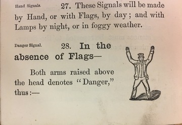 "Danger Signal: Both arms raised above the head denotes ""Danger""."