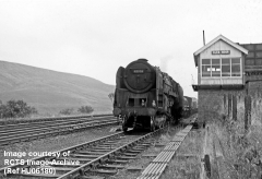 Blea Moor Signal Box and 'Up' Tank House from the south with Cl 9F No. 92208.