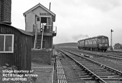 Blea Moor Signal Box from the north with a DMU passing on the 'Down' main line.