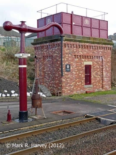 Appleby station rebuilt tank house and 'Up' side water crane, from the west (1).