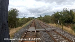 302460: Level Crossing: Cab-view video-still (northbound)