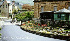 Settle Station drive, flower beds, coal merchants' office and tank house