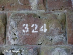 Bridge SAC/324 - Station road: Bridge number stencilled on NW pier stonework
