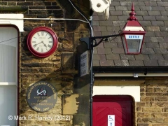 Settle Station: clock, bracket lamp and 125th anniversary plaque