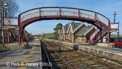Kirkby Stephen Station footbridge, booking office and 'Up' platform from SE