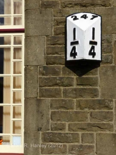 Ribblehead Station Booking Office: Detail view, milepost and window-frame